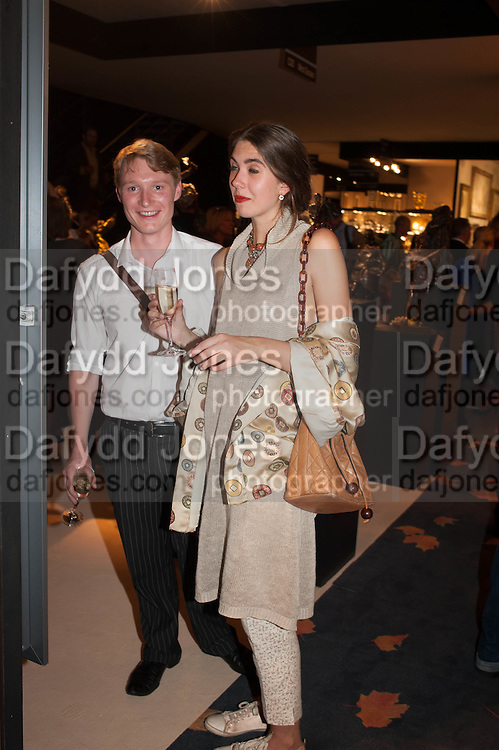 Matthew Holder and Kitty Verity at the Opening of The LAPADA  Art and Antiques Fair. Berkeley Sq. London. 24 September 2013.