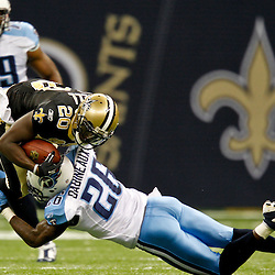 September 1, 2011; New Orleans, LA, USA; Tennessee Titans defensive back Jordan Babineaux (26) tackles New Orleans Saints running back Joique Bell (20) during the first quarter of a preseason game at the Louisiana Superdome. Mandatory Credit: Derick E. Hingle