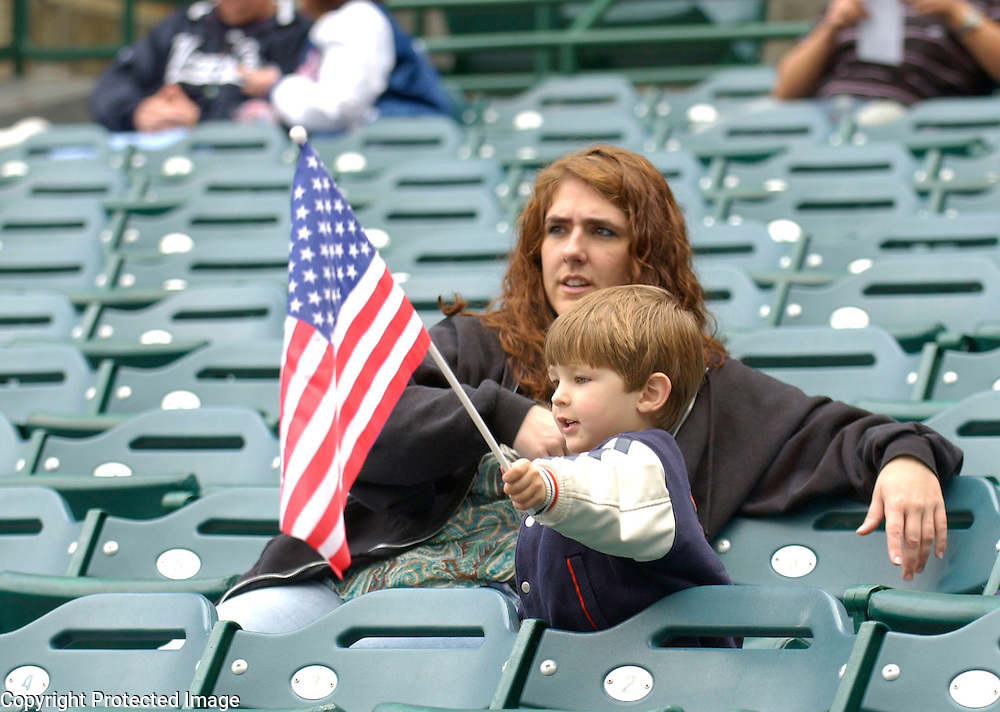 A young fan holds up the USA Flag during pregame warm ups before the start of Round 2 action matching Team Japan and Team USA at Angel Stadium of Anaheim.