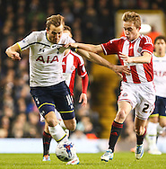 Harry Kane of Tottenham Hotspur holds off Louis Reed of Sheffield United during the Capital One Cup Semi-Final 1st Leg match between Tottenham Hotspur and Sheffield Utd at White Hart Lane, London, England on 21 January 2015. Photo by David Horn.