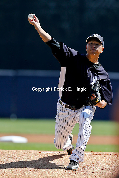 Mar 16, 2013; Tampa, FL, USA; New York Yankees starting pitcher Hiroki Kuroda (18) against the Philadelphia Phillies during a spring training game at George Steinbrenner Field. Mandatory Credit: Derick E. Hingle-USA TODAY Sports