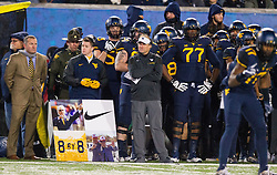 Nov 19, 2016; Morgantown, WV, USA; West Virginia Mountaineers head coach Dana Holgorsen and players look on during the second quarter against the Oklahoma Sooners at Milan Puskar Stadium. Mandatory Credit: Ben Queen-USA TODAY Sports