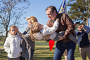 U.S. Senator and GOP presidential candidate Ted Cruz plays with daughter Catherine as wife Heidi and daughter Caroline join them onstage during a campaign event at Ottawa Farms December 19, 2015 in Bloomingdale, Georgia.