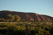Ayers rock stretches across the Australian outback