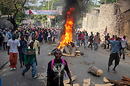 Port-au-Prince residents clashed with UN peacekeepers, hurling stones and building blockades in protest of the previous evening's announcement of preliminary results in the country's presidential elections.