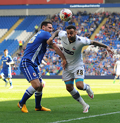 Cardiff City's Sean Morrison tussles with Bolton Wanderers' Craig Davies - Photo mandatory by-line: Paul Knight/JMP - Mobile: 07966 386802 - 06/04/2015 - SPORT - Football - Cardiff - Cardiff City Stadium - Cardiff City v Bolton Wanderers - Sky Bet Championship
