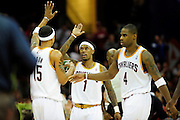 Feb. 11, 2011; Cleveland, OH, USA; Cleveland Cavaliers small forward Jamario Moon (15) celebrates with point guard Daniel Gibson (1) and power forward Antawn Jamison (4) after a three point shot during the second quarter against the Los Angeles Clippers at Quicken Loans Arena. Mandatory Credit: Jason Miller-US PRESSWIRE