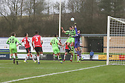 Forest Green Rovers Darren Carter(12) and Woking goalkeeper Michael Poke(1) jump for the ball during the Vanarama National League match between Forest Green Rovers and Woking at the New Lawn, Forest Green, United Kingdom on 25 February 2017. Photo by Shane Healey.