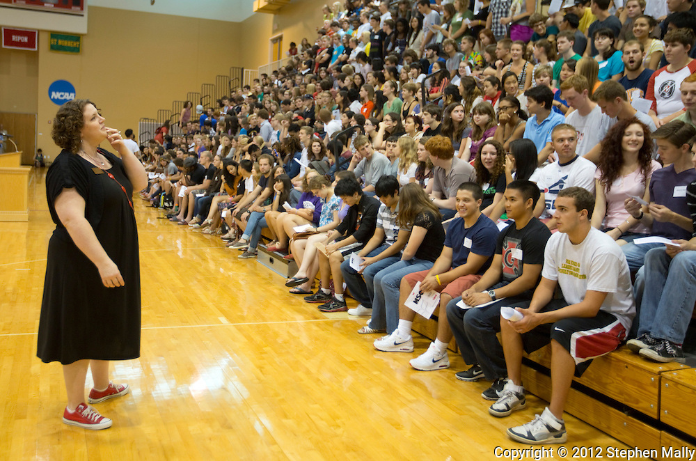 Andrea Conner, Assistant Dean of Students and Director of Residence Life and Orientation, works on organizing the new students for a class photo before the start of the New Student Orientation Welcome Ceremony in the Darby Gymnasium at Grinnell College in Grinnell, Iowa on Saturday, August 25, 2012.