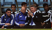 Chelsea manager Guus Hiddink chats to a clearly impressed Ray Wilkins during the Barclays Premier League match between Aston Villa and Chelsea at Villa Park on February 21, 2009 in Birmingham, England.