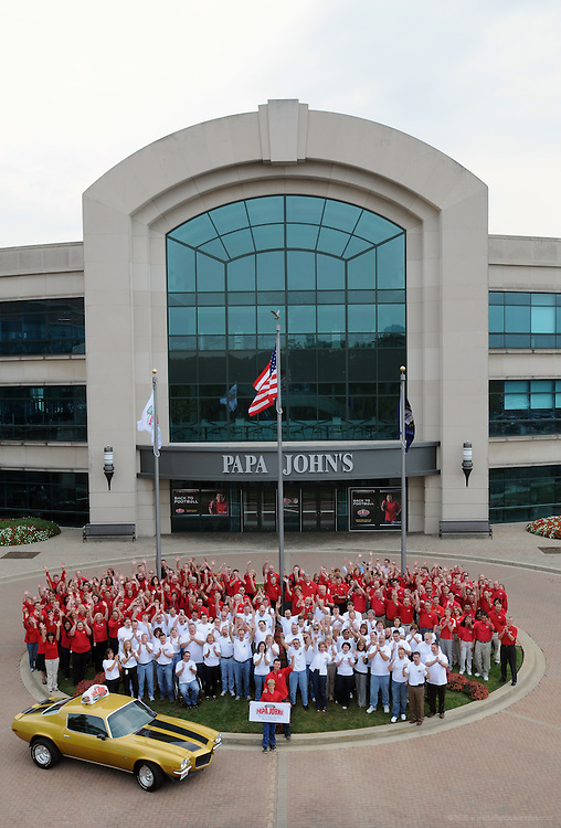 John Schnatter, founder of Papa John's, stands with his 12 year-old son, Beau, and corporate staff outside the company headquarters after a rollout of the company's revamped website. Papa John's was the first pizza company to introduce online ordering in 2001 at www.papajohns.com and the brand has since transacted more than $2 billion in online sales. Schnatter started the business in the broom closet of his father's tavern 26 years ago and the company has grown to be the world's third largest pizza chain. Until last week, he had never ordered a pizza online. Schnatter's order, made from his home in Louisville, Ky., can be watched on www.facebook.com/papajohns.