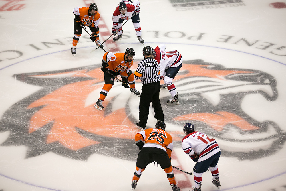 RIT Senior Captain Matt Garbowsky and Brock University's Gregory Jambrosich take a face-off during a game at the Gene Polisseni Center on Saturday, October 4, 2014.