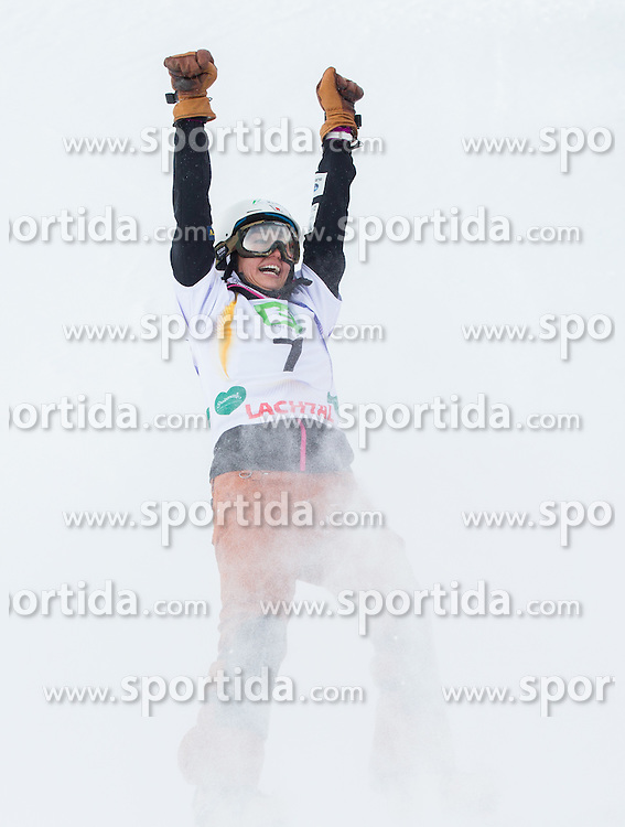 Tomoka Takeuchi of Japan celebrates at finish line after placed third during the Ladies' Parallel Giant Slalom at FIS World Championships of Snowboard and Freestyle 2015, on January 23, 2015 at the WM Piste in Lachtal, Austria. Photo by Vid Ponikvar / Sportida