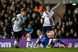Andy King of Leicester City crosses the ball under pressure from Tottenham Hotspur defenders - Mandatory byline: Jason Brown/JMP - 07966386802 - 10/01/2016 - FOOTBALL - White Hart Lane - London, England - Tottenham v Leicester City - The Emirates FA Cup