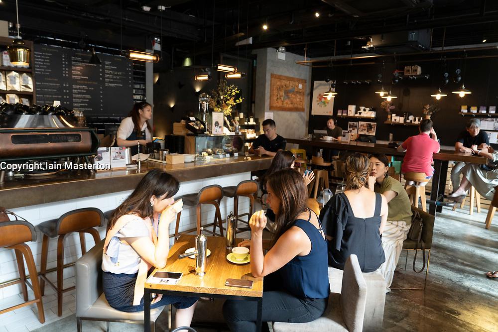 Interior of upmarket coffee shop called Coffee Academics in Hong Kong.