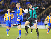 Jack Grimmer, Grant Holt during the Sky Bet League 1 match between Shrewsbury Town and Rochdale at Greenhous Meadow, Shrewsbury, England on 1 March 2016. Photo by Daniel Youngs.