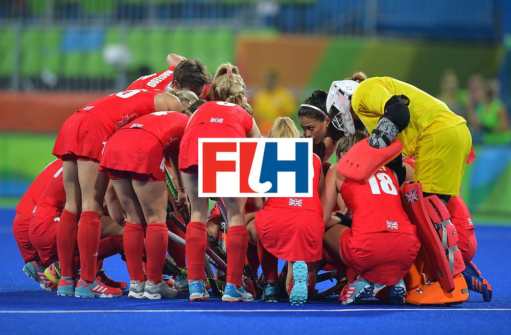 The Britain team speaks before the start of the women's field hockey Britain vs Australia match of the Rio 2016 Olympics Games at the Olympic Hockey Centre in Rio de Janeiro on August, 6 2016. / AFP / Carl DE SOUZA        (Photo credit should read CARL DE SOUZA/AFP/Getty Images)