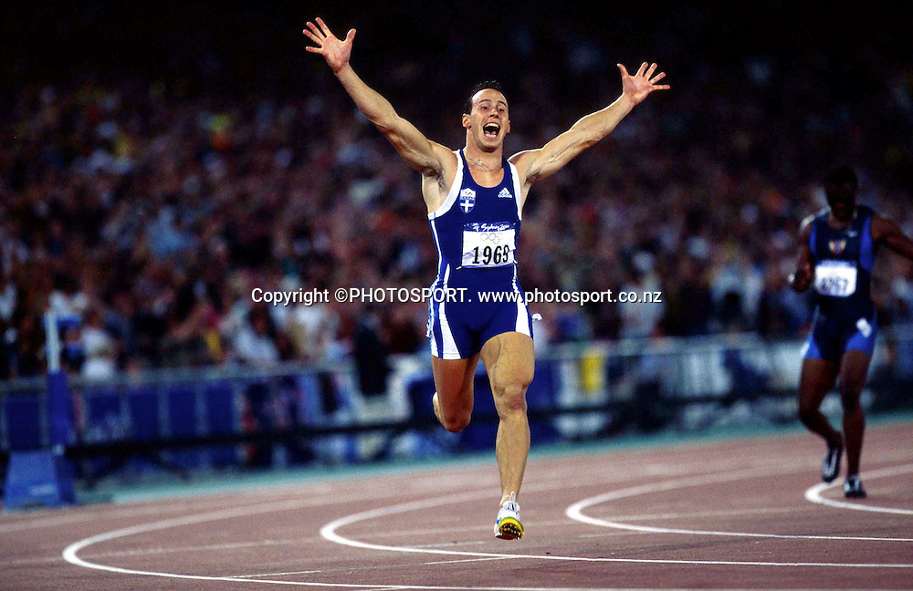 Konstantinos Kenteris of Greece celebrates after winning Mens 200m Final, at the Sydney Olympic Games on September 28 2000. Photo: Andrew Cornaga/PHOTOSPORT<br />