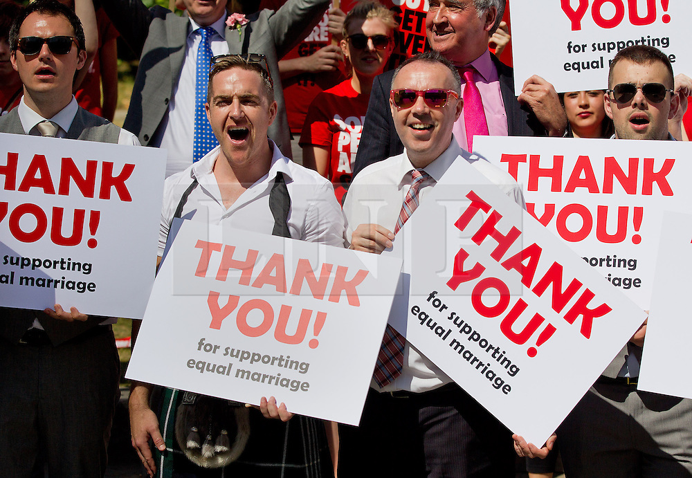 © Licensed to London News Pictures. 15/07/2013. London, UK. Supporters of lesbian, gay and bisexual charity Stonewall accompanied by the London Gay Men's Chorus are seen campaigning outside Parliament in London today (15/07/2013) as MP's hear the final reading of a proposed bill to allow same sex marriages to become law. Photo credit: Matt Cetti-Roberts/LNP