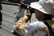 senior woman photographing Japan