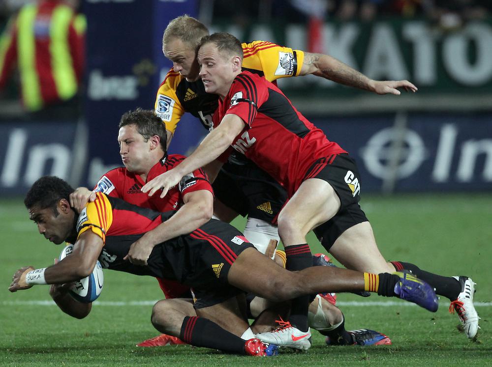 Chiefs' Asaeli Tikoirotuma is tackled by Crusaders' Tom Taylor and Crusaders' Andy Ellis in a Super Rugby semi final match, Waikato Stadium, Hamilton, New Zealand, Saturday, July 27, 2013.  Credit:SNPA / David Rowland