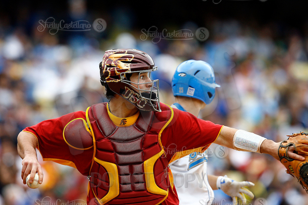 28 February 2010:  #27 catcher Keith Castillo of the USC Trojans Baseball team during the first annual Dodgertown Classic at Dodger Stadium at Chavez Ravine. A college baseball round robin tournament sponsored by the MLB Los Angeles Dodgers. 14,588 were in attendance to watch the UCLA Bruins defeat the USC Trojans 6-1 on a sunny afternoon in Southern California.