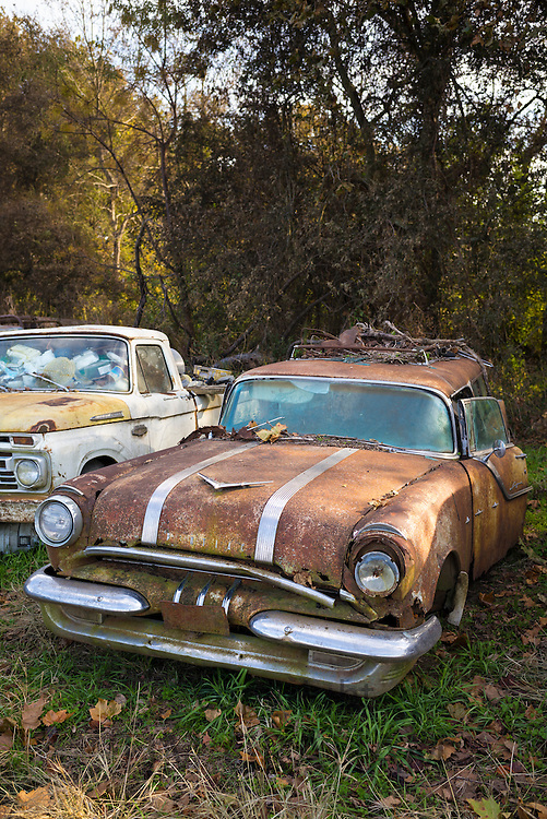 Pontiac auto limo in graveyard of abandoned rusty old American automobiles, MIssissippi, USA