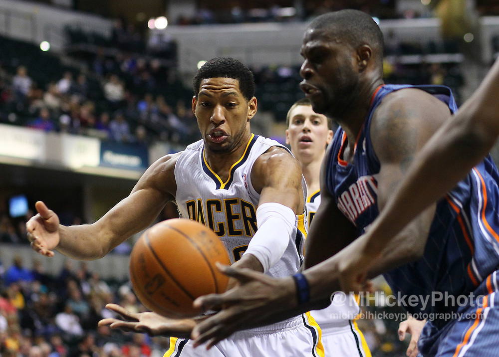 Feb. 09, 2011; Indianapolis, IN, USA; Indiana Pacers forward Danny Granger (33) and Charlotte Bobcats center Nazr Mohammed (13) battle for a loose ball at Conseco Fieldhouse. Indiana defeated Charlotte 104-103. Mandatory credit: Michael Hickey-US PRESSWIRE