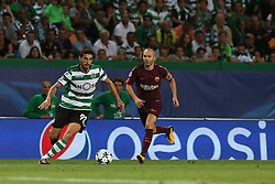 September 27, 2017 - Lisbon, Lisbon, Portugal - Sportings defender Cristiano Piccini from Italy (L) and Barcelonas midfielder Andres Iniesta from Spain (R) during the match between Sporting CP v FC Barcelona UEFA Champions League playoff match at Estadio Jose Alvalade on September 27, 2017 in Lisbon, Portugal. (Credit Image: © Dpi/NurPhoto via ZUMA Press)