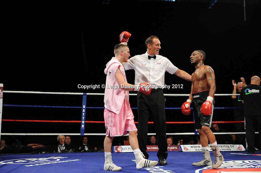 Louis Norman defeats Delroy Spencer in a Flyweight contest at the Velodrome, Manchester on the 16.06.12. Hatton Promotions. ©Leigh Dawney Photography 2012.