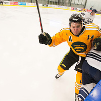 4th year forward Ian McNulty (14) of the Regina Cougars in action during the Men's Hockey Home Game on January 20 at Co-operators arena. Credit: Arthur Ward/Arthur Images