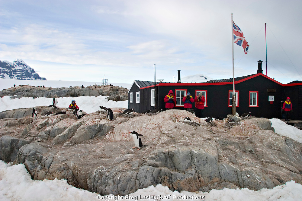Tourists visiting Gentoo Penguin colony.Port Lockroy, Antarctica.Antarctic Peninsula.25 December 2003