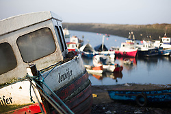 © Licensed to London News Pictures. 13/03/2014<br /> <br /> South Gare, Teesside, England, UK<br /> <br /> Fishing boats are moored in an area known as Paddy's Hole at South Gare on the mouth of the River Tees on Teesside.<br /> <br /> Photo credit : Ian Forsyth/LNP
