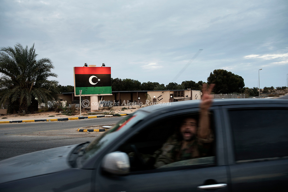 Libya, Sirte:  on November 25, 2016, a fighter of the Libyan forces affiliated to the Tripoli government flashes the &quot;V&quot; of victory as he drives in Zafaran square.<br /> The square use to be the place where ISIS made executions in Sirte. Alessio Romenzi