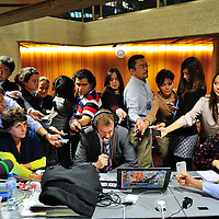 EEU High Representative Catherine Ashton's spokesperson Michael Mann giving a radio interview to the BBC surrounded by members of the international press, recording him as he speaks, at the press center  following the first day of the first round of E3/EU+3 Iran talks in Geneva concerning Iran's nuclear program. (E3/EU +3 refers to UK, France and Germany plus U.S., Russia and China.) .