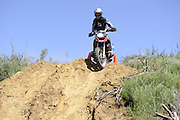 Bill Dragoo of Norman descending steep slope during day 1 competition at 2010 Rawhyde Adventure Rider Challenge