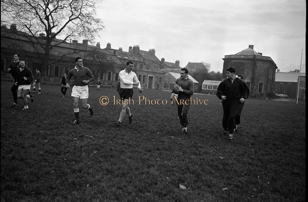 The Welsh Rugby Team to meet Ireland in the postponed international at Lansdowne Road practice on the eve of the match at Trinity College, Dublin..1962. .16.11.1962..11.16.1962..16th November 1962...Image shows the Welsh Rugby team practicing on the pitch at Trinity College, Dublin.