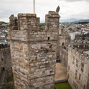 The Eagle Tower at Caernarfon Castle in northwest Wales. A castle originally stood on the site dating back to the late 11th century, but in the late 13th century King Edward I commissioned a new structure that stands to this day. It has distinctive towers and is one of the best preserved of the series of castles Edward I commissioned.