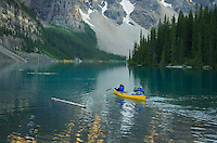 Canoeists paddling on Moraine Lake, Banff National Park Alberta Canada