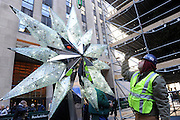 For the 10th year, the Swarovski Star is raised to the top of the 76-foot Rockefeller Center Christmas tree, Thursday, Nov. 14, 2013, in New York.  The Star, features 25,000 crystals and weighs 550 pounds, will sit atop the Rockefeller Center Christmas tree which will be lit on Dec. 4th.    (Diane Bondareff/Invision for Swarovski)