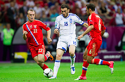 Vassilis Torossidis  of Greece between Denis Glushakov of Russia and Roman Shirokov of Russia during the UEFA EURO 2012 group A match between  Greece and Russia at The National Stadium on June 16, 2012 in Warsaw, Poland.  (Photo by Vid Ponikvar / Sportida.com)