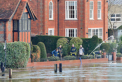 © Licensed to London News Pictures. 09/01/2014. Marlow, UK. Fire fighters pump water from a flooded property. Rising river levels in the River Thames at Marlow in Buckinghamshire have led to flooding and property damage along the river today 9th January 2014. Large areas of Britain are experiencing flooding after wet weather. Photo credit : Stephen Simpson/LNP