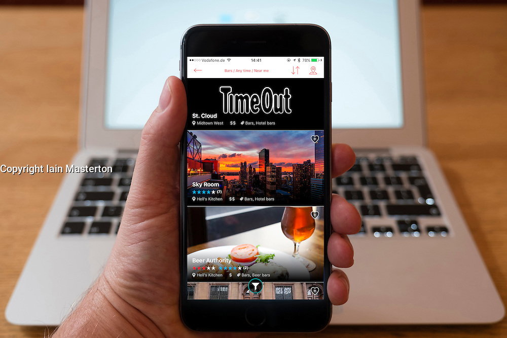 Using iPhone smartphone to display homepage of TimeOut New York edition