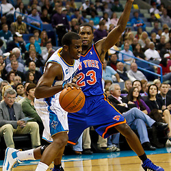December 3, 2010; New Orleans, LA, USA; New Orleans Hornets point guard Chris Paul (3) drives past New York Knicks guard Toney Douglas (23) during the first half at the New Orleans Arena. Mandatory Credit: Derick E. Hingle