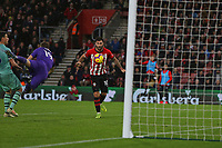 Football - 2018 / 2019 Premier League - Southampton vs. Arsenal<br /> <br /> Southampton's Charlie Austin heads into the open net after Bernd Leno of Arsenal fails to clear a cross at St Mary's Stadium Southampton<br /> <br /> COLORSPORT/SHAUN BOGGUST