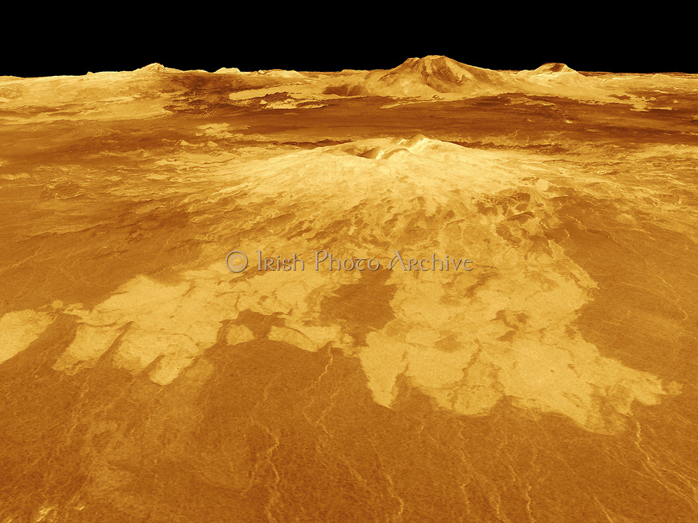 Sapas Mons is displayed in the centre of this computer-generated three-dimensional perspective view of the surface of Venus. The viewpoint is located 527 kilometres (327 miles) northwest of Sapas Mons at an elevation of 4 kilometres (2.5 miles) above the terrain. Lava flows extend for hundreds of kilometres across the fractured plains shown in the foreground to the base of Sapas Mons. The view is to the southeast with Sapas Mons appearing at the centre with Maat Mons located in the background on the horizon. Sapas Mons, a volcano 400 kilometres (248 miles) across and 1.5 kilometres (0.9 mile) high is located at approximately 8 degrees north latitude, 188 degrees east longitude, on the western edge of Atla Regio. Its peak sits at an elevation of 4.5 kilometres (2.8 miles) above the planet's mean elevation. Sapas Mons is named for a Phoenician goddess