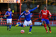 Tomasz Cywka with a shot during the The FA Cup match between Aldershot Town and Rochdale at the EBB Stadium, Aldershot, England on 7 December 2014.