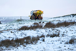 © Licensed to London News Pictures. 12/01/2017. High Shaw UK. Picture shows a gritter out working this morning as drivers faced difficult driving conditions this morning on the snow covered Buttertubs pass in the Yorkshire Dales. Photo credit: Andrew McCaren/LNP