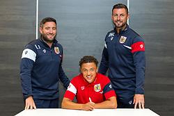Bristol City Head Coach Lee Johnson and Assistant Head Coach Jamie McAllister look on as Ashley Harper signs a new contract with Bristol City Under 23s ahead of the 2017/18 Season - Rogan/JMP - 11/07/2017 - Ashton Gate Stadium - Bristol, England.
