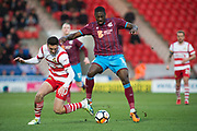 Scunthorpe United striker Hakeeb Adelakun (16) (right) is tackled by Doncaster Rovers Defender Tyler Garrett (20)  (keft) during the The FA Cup match between Doncaster Rovers and Scunthorpe United at the Keepmoat Stadium, Doncaster, England on 3 December 2017. Photo by Craig Zadoroznyj.